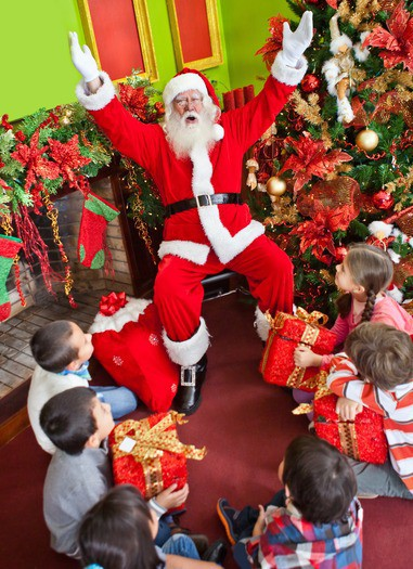 Group of kids with Santa Claus at Christmas time